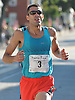 Stephen Pifer of Superior, CO legs out the final stretch of  Northport's annual Cow Harbor 10K run on Saturday, Sept. 17, 2016. He finished in second place with a time of 29:37.53.