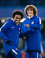 David Luiz & Willian of Chelsea during the pre match warm ups ahead of the Carabao Cup semi final 1st leg match between Chelsea and Arsenal at Stamford Bridge, London, England on 10 January 2018. Photo by Andy Rowland.