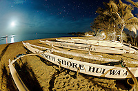 North Shore Hui Wa'a outrigger canoes on the beach at night on the North Shore in Haleiwa, O'ahu