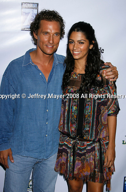 "MALIBU, CA. - September 10: Producer/Actor Matthew McConaughey and Designer Camilla Alves arrive at the ""Surfer Dude"" premiere at the Malibu Cinemas on September 10, 2008 in Malibu, California."