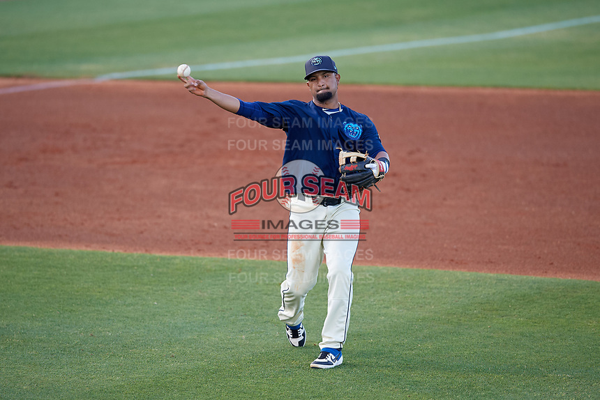 Mobile BayBears third baseman Roberto Baldoquin (27) throws to first base during a Southern League game against the Jacksonville Jumbo Shrimp on May 7, 2019 at Hank Aaron Stadium in Mobile, Alabama.  Mobile defeated Jacksonville 2-0.  (Mike Janes/Four Seam Images)