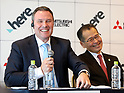 October 27, 2017, Tokyo, Japan - Dutch open location platform company HERE Technologies president Edzard Overbeek (L) and Japan's Mitsubishi Electric senior vice president Isao Iguchi announce to collaborate their technologies for autonomous driving technologies in Tokyo on Friday, October 27, 2017. World's largest positioning service company HERE will use Mitsubishi's high definition location technology with quasi-zenith satellite system.   (Photo by Yoshio Tsunoda/AFLO) LWX -ytd-