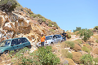Pictured: Emergency services and a pathologist near the scene in Ikaria, Greece. Thursday 08 August 2019<br /> Re: Rescuers searching for  British scientist Natalie Christopher, 35, who disappeared on the  island of Ikaria, Greece have found her body at the bottom of a ravine.<br /> She was found less than a mile from the hotel in the Kerame area where she was on holiday with her Cypriot partner.<br /> Emergency service staff said that a large rock had dislodged as she fell, causing multiple head injuries.<br /> The woman's body will be kept overnight at the spot so a coroner can examine it on Thursday morning.