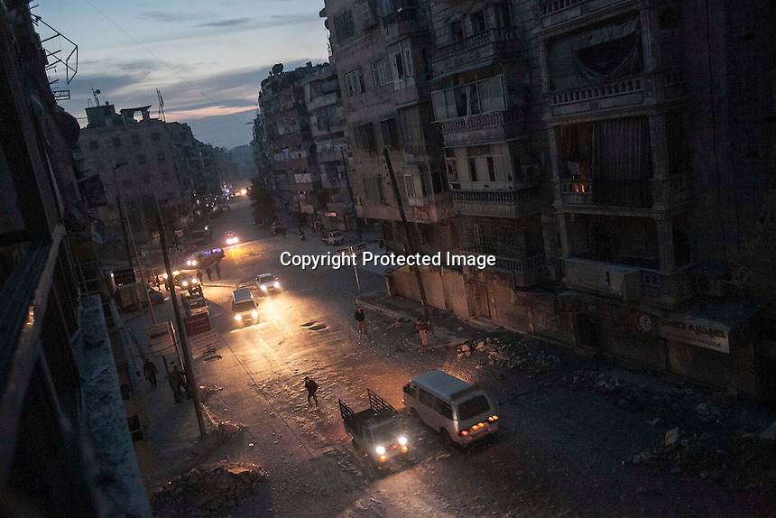 In this Thursday, Nov. 29, 2012 photo, night falls on a Syrian-rebel controlled area in Sa'ar street which has been heavely punished by airstrikes and shelling during months of fighting in Aleppo, the Syrian's largest city. (AP Photo/Narciso Contreras).