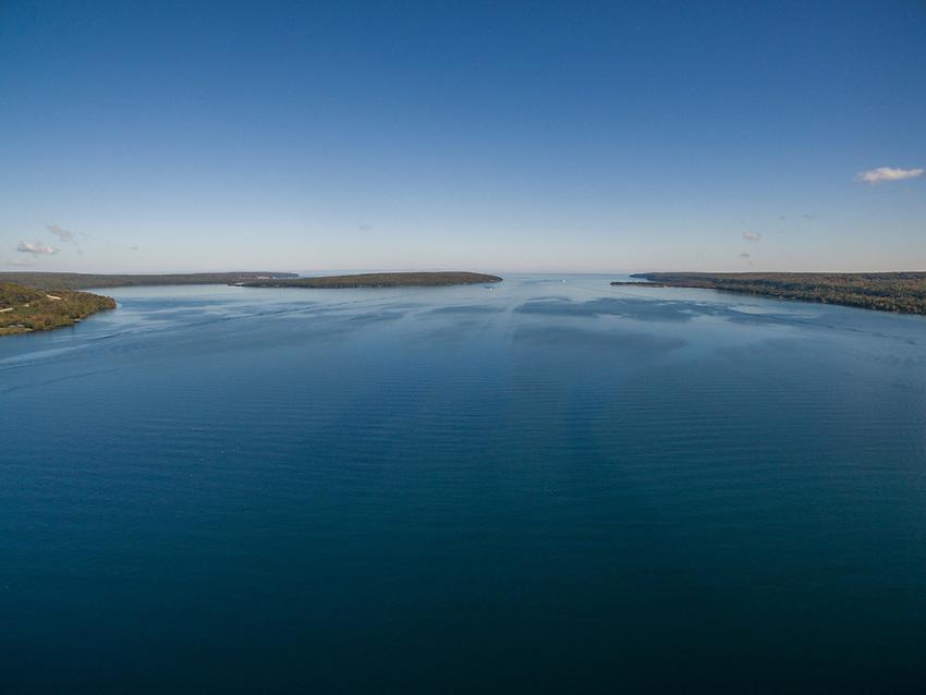 Aerial drone image of Lake Superior, Munising Bay and Grand Island at Munising,  Michigan.