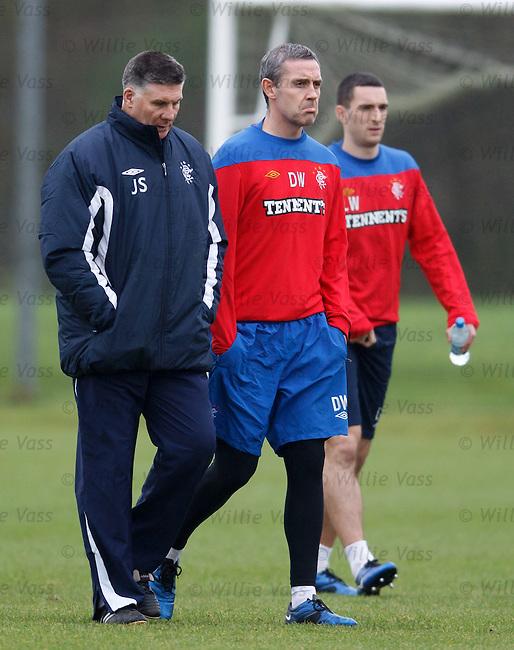 Jim Stewart walks out with a grumpy Davie Weir