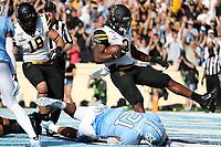 CHAPEL HILL, NC - SEPTEMBER 21: Darrynton Evand #3 of Appalachian State University scores a touchdown during a game between Appalachian State University and University of North Carolina at Kenan Memorial Stadium on September 21, 2019 in Chapel Hill, North Carolina.