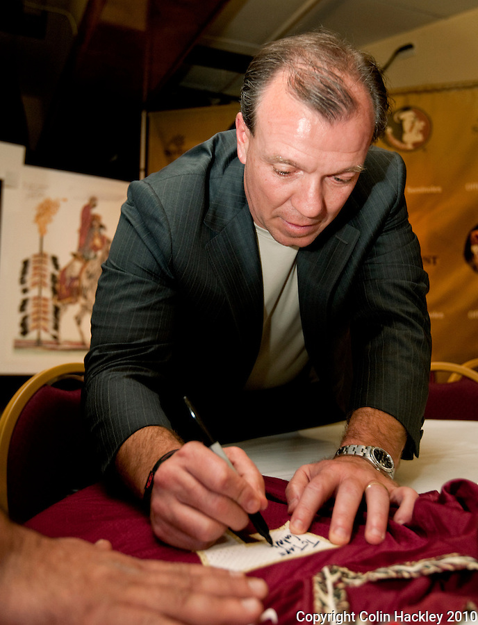 TALLAHASSEE, FLA. 2/3/10-FSU SIGN10 CH30-Head Coach Jimbo Fisher signs autographs after the FSU Signing Day Spectacular Wednesday in Tallahassee...COLIN HACKLEY PHOTO