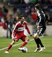 Chicago Fire midfielder Marco Pappa (16) makes a move against DC United midfielder Marc Burch (4).  The DC United defeated the Chicago Fire 1-0 at Toyota Park in Bridgeview, IL on August 29, 2009.