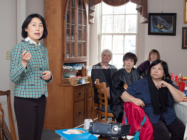 ROXBURY CT- JANUARY 23 2013 -012313DA03- Volunteer for CT Falun Dafa Association, Tracey Zhu gives a slide presentation during a Chinese New Year luncheon at the Roxbury Senior Center on Wednesday..Darlene Douty Republican American