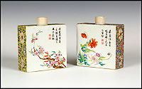BNPS.co.uk (01202 558833)<br /> Pic: Tooveys/BNPS<br /> <br /> A pair of exceptionally rare Chinese tea caddies that spent the last 40 years on a windowsill have sold for a whopping &pound;165,000 - 160 times their estimate. <br /> <br /> The delicate porcelain relics, commissioned by the Qing dynasty in the 18th century, were purchased by the unwitting vendor half a century ago. <br /> <br /> Thought to be a pair of 'pretty pots', they had sat on display in her living room for half a century until they were spotted by an eagle-eyed auctioneer. <br /> <br /> A notable Hong Kong collector overcame competition to buy the pair for &pound;132,000. With fees added on the total price came to &pound;165,000.