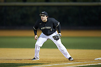 Wake Forest Demon Deacons first baseman Bobby Seymour (3) on defense against the Illinois Fighting Illini at David F. Couch Ballpark on February 16, 2019 in  Winston-Salem, North Carolina.  The Fighting Illini defeated the Demon Deacons 5-2. (Brian Westerholt/Four Seam Images)