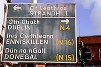 Highway sign in English and Gaelic at the head of O'Connell Street in downtown Sligo City, Ireland.