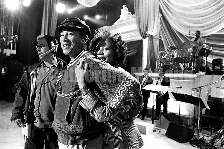 "NEW YORK - April 1993:  Aretha Franklin hugs Smokey Robinson at a rehearsal for the ""Aretha Franklin: Duets"" concert to benefit the Gay Men's Health Crisis at the Nederlander Theater in April 1993 in New York City, New York. The concert was taped and broadcast on the Fox Network on May 9, 1993. (Photo by Catherine McGann)Copyright 2010 Catherine McGannCopyright 2010 Catherine McGann"