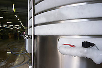 Mas La Chevaliere. near Beziers. Languedoc. Cold stabilisation stabilization tanks with ice on the cooling coils. Stainless steel fermentation and storage tanks. France. Europe.