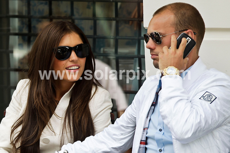 **ALL-ROUND EXCLUSIVE PICTURES FROM SOLARPIX.COM**.**UK SYNDICATION RIGHTS ONLY**.Inter Milan player Wesley Sneijder and girlfriend Yolanthe Cabau van Kasbergen were seen shopping and having a drink in Amsterdam, Netherlands. 24 May 2010..This pic: Wesley Sneijder and Yolanthe Cabau van Kasbergen..JOB REF: 11307 GHJ      DATE: 24_05_2010.**MUST CREDIT SOLARPIX.COM OR DOUBLE FEE WILL BE CHARGED**.**MUST AGREE FEE BEFORE ONLINE USAGE**.**CALL US ON: +34 952 811 768 or LOW RATE FROM UK 0844 617 7637**