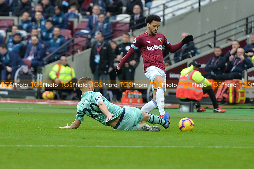 Shkodran Mustafi of Arsenal tackles Felipe Anderson during West Ham United vs Arsenal, Premier League Football at The London Stadium on 12th January 2019