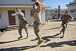 """Spc. Irwin Davis, center, plays a game of """"500"""" as he and his fellow members of the 432nd Civil Affairs Battalion relax at Fort Bragg, NC on January 27, 2008. The unit enters the final phase of its training before being deployed to Iraq."""