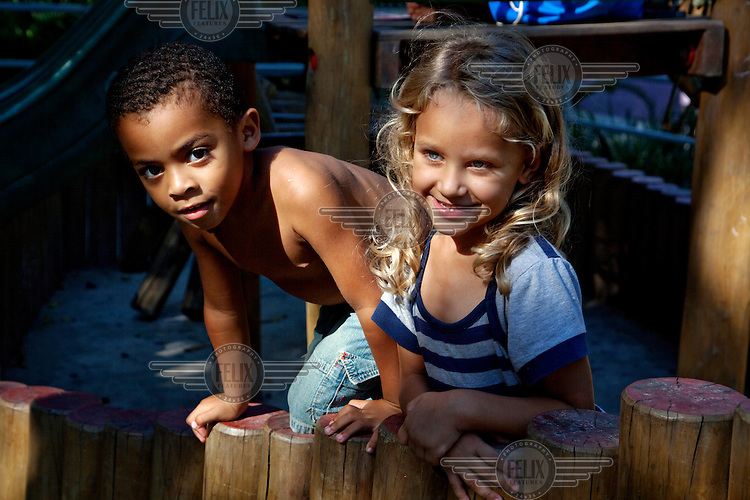 Children enjoying themselves in a newly constructed playground, part of the Morar Carioca urbanising project, in the Morro da Babilonia favela.