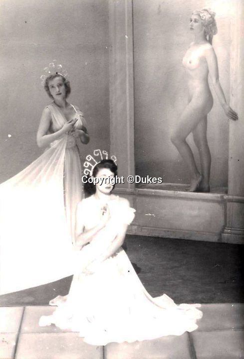 BNPS.co.uk (01202 558833)<br /> Pic: Dukes/BNPS<br /> <br /> The levels of clothing were linked to the amount of movement - naked 'artists' had to remain stock still...<br /> <br /> 'If it moves, its rude' risque routines that escaped censure in the 1950's revealed in photo album from the legendary Windmill Theatre.<br /> <br /> Racy photos of scantily clad women performing at an iconic theatre have been unearthed which reveal that post-war London was not quite as conservative as some would imagine.<br /> <br /> Dancers at the Windmill Theatre in Soho would pose nude as 'living statues' to exploit a quirky legislation loophole permitting them to bare all if stood completely still. <br /> <br /> They were not allowed to move because this would have been a breach of licensing regulations which adopted the position 'if it moves, it's rude'. <br /> <br /> As a result, men from across the globe savoured the delights of the venue in central London, and there would often be fights over front row seats as they battled for the best views.<br /> <br /> The photos will be sold at Duke's Auctioneers of Dorchester on March 21.