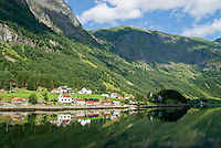 reflection of small village on the shore of Naeroyfjord, Gudvangen, Norway