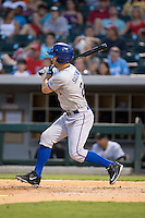 Grady Sizemore (21) of the Durham Bulls follows through on his swing against the Charlotte Knights at BB&T BallPark on July 22, 2015 in Charlotte, North Carolina.  The Knights defeated the Bulls 6-4.  (Brian Westerholt/Four Seam Images)
