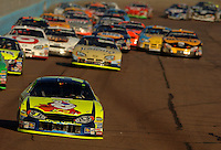 Nov 13, 2005; Phoenix, Ariz, USA;  Nascar Nextel Cup driver Kyle Busch driver of the #5 Kellogs Chevy leads the field at the Checker Auto Parts 500 at Phoenix International Raceway. Mandatory Credit: Photo By Mark J. Rebilas
