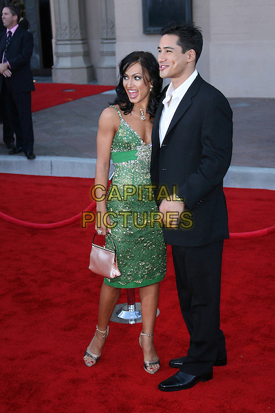 KARINA SMIRNOFF & MARIO LOPEZ.34th Annual American Music Awards - Arrivals held at the Shrine Auditorium, Los Angeles, California, USA. - Arrivals.November 21st, 2006.full length dress green black suit.CAP/ADM/ZL.©Zach Lipp/AdMedia/Capital Pictures