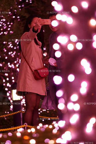 People take a selfie under the illuminations at Shinjuku Terrace City on November 16, 2017, Tokyo, Japan. Shinjuku Terrace City Illuminations are seen around Odakyu Line Shinjuku Station. This year marks the 12th year of the illumination event, which can be enjoyed until February 22, 2018. (Photo by Rodrigo Reyes Marin/AFLO)