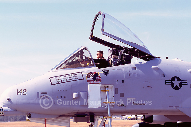 Pilot sitting in Cockpit of US Air Force Fairchild Republic A-10 Thunderbolt II Military Aircraft on Static Display - at Abbotsford International Airshow, BC, British Columbia, Canada
