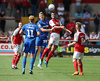Fleetwood Town's Tommy Spurr and Wimbledon's Joe Pigott<br /> <br /> Photographer Stephen White/CameraSport<br /> <br /> The EFL Sky Bet League One - Fleetwood Town v AFC Wimbledon - Saturday 4th August 2018 - Highbury Stadium - Fleetwood<br /> <br /> World Copyright &copy; 2018 CameraSport. All rights reserved. 43 Linden Ave. Countesthorpe. Leicester. England. LE8 5PG - Tel: +44 (0) 116 277 4147 - admin@camerasport.com - www.camerasport.com