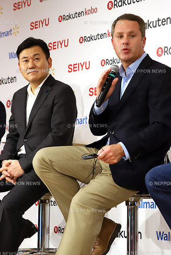 "January 26, 2018, Tokyo, Japan -  US retail giant Walmart president Doug McMillon speaks while Japanese online commerce giant Rakuten president Hiroshi Mikitani looks on as they announce a new strategic alliance on the e-commerce at the Rakuten headquarters in Tokyo on Friday, January 26, 2018. Rakuten and Walmart will launch a new online grocery delivery service ""Rakuten Seiyu Netsuper"" in Japan in this year. (Photo by Yoshio Tsunoda/AFLO) LWX -ytd-"