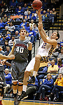 BROOKINGS, SD - JANUARY 18:  Brayden Carlson #12 from South Dakota State University shots after being fouled by Simon Krych #40 from Omaha in the first half of their Summit League game Saturday afternoon at Frost Arena in Brookings. (Photo by Dave Eggen/Inertia)