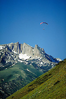 Parasailers fly high at the Point of the Mountain with Lone Peak in the background. Parasailing. Connotations - Daring, courage, serenity. sports, hills, mountains, landscape. Utah, Point of the Mountain.