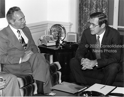 Minister of Defense Shimon Peres (left) of Israel visits United States Secretary of Defense Donald H. Rumsfeld in his Pentagon office in Washington, D.C. on December 16, 1975..Mandatory Credit:  Robert D. Ward / DoD via CNP