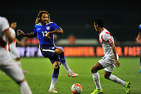 Jermaine Jones of the US kicks the ball against Peru's Juan Manuel Vargas. USA defeated Peru 2-1 during a Friendly Match at the RFK Stadium in Washington, D.C. on Friday, September 4, 2015.  Alan P. Santos/DC Sports Box