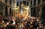 """Christians Orthodox take part in Easter """"Holy Fire"""" celebrations on the eve of Easter Sunday on April 23, 2011, at the Church of the Holy Sepulchre, built over the sites where Christians believe Christ was crucified and buried in Israeli annexed east Jerusalem's Old City. Tens of thousands of Christian pilgrims from Eastern churches converged on the Holy City to take part in the Easter """"Holy Fire"""" vigil in which the """"miracle"""" light from Jesus' tomb is shared by candles to the crowd. Photo by Sliman Khader"""