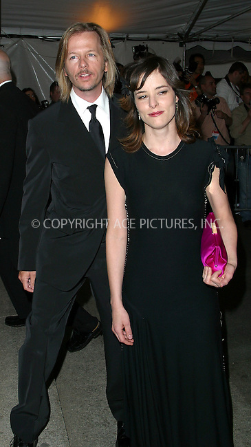 """David Spade and Parker Posey arrive at the Costume Institute Gala, """"Goddess"""" at Metropolitan Museum of Art in New York. April 28, 2003. Please byline: Alecsey Boldeskul/NY Photo Press.   ..*PAY-PER-USE*      ....NY Photo Press:  ..phone (646) 267-6913;   ..e-mail: info@nyphotopress.com"""