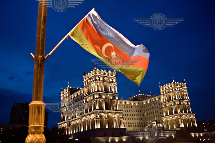 An Azerbaijan flag flies from a lamppost in front of Government House in Azadlig square.