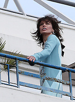 Milla Jovovich poses for photoshoot at the Martinez Hotel - 66th Cannes Film Festival