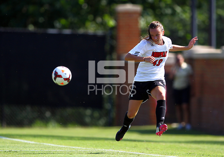 WINSTON-SALEM, NORTH CAROLINA - August 30, 2013:<br />  Megan Berberich (49) of Louisville University sends over a cross against Virginia Tech during a match at the Wake Forest Invitational tournament at Wake Forest University on August 30. The game ended in a 1-1 tie.