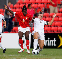 Santa Clara forward (5) Kiki Bosio tackles the ball away from Maryland forward (3) Jasmyne Spencer.  Maryland defeated Santa Clara, 1-0, at Ludwig Field in College Park Maryland.