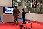 October 16, 2012. Raleigh, North Carolina.. Slater Mapp and his daughter Emily, age 13, attended the exhibition. Ms. Mapp was assigned to watch the debate by a treater at her school.. Locals gathered at the Contemporary Art Museum to see artist Jonathan Horowitz's simultaneous exhibitions about the presidential election titled ?Your Land/My Land?..  A room is divided in two, with blue carpet, democrats on one side, and red carpet, republicans, on the other. TV's on both sides are supposed to play either FOX news, red, or CNN, blue. Because of the audio delay between the 2 channels, both sides played CNN during the 2nd presidential debate..