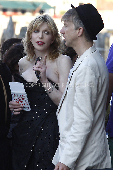WWW.ACEPIXS.COM . . . . .  ..... . . . . US SALES ONLY . . . . .....June 2 2011, Venice....Courtney Love and Jefferson Hack at the opening gala of  Corner della Regina during the Venice Biennale on June 2 2011 in Venice....Please byline: FAMOUS-ACE PICTURES... . . . .  ....Ace Pictures, Inc:  ..Tel: (212) 243-8787..e-mail: info@acepixs.com..web: http://www.acepixs.com