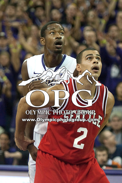 Jan 10, 2012:  Washington's Terrance Ross battles Seattle University's Aaron Broussard for position under the basket.  Washington defeated Seattle University  91-83 at Alaska Airlines Arena Seattle, Washington..