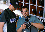 21 July 2007: Photographer Mark Goldman shows a photograph to Colorado Rockies pitcher Jeff Francis prior to a game between the Colorado Rockies and the Washington Nationals at RFK Stadium in Washington, DC. The Nationals defeated the Rockies 3-0 in the third game of their 4-game series...Mandatory Photo Credit: Ed Wolfstein Photo