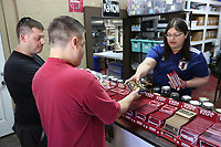 NWA Democrat-Gazette/DAVID GOTTSCHALK Jennifer Pocasangre (from right), manager of inventory and retail, assists Jeff and Danial Marino Wednesday, July 3, 2019, as they select a variety of chocolates at the Kyya Chocolate Factory and Tasting Room in Elm Springs. Kyya was the first bean to bar chocolate comparing in Arkansas and the name comes from the Greek, KAIA, which means pure, simple, or straight forward.