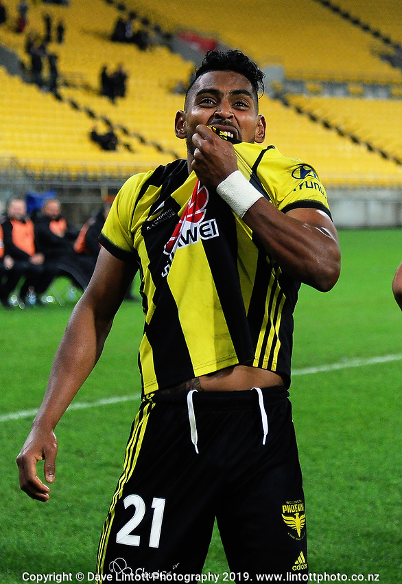Roy Krishna kisses his jersey badge after scoring the matchwinner during the A-League football match between Wellington Phoenix and Melbourne City FC at Westpac Stadium in Wellington, New Zealand on Sunday, 21 April 2019. Photo: Dave Lintott / lintottphoto.co.nz