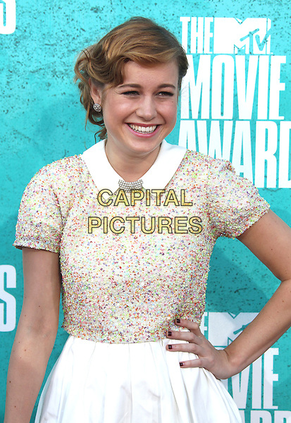 Brie Larson.2012 MTV Movie Awards held at the Gibson Amphitheatre, Universal City, California, USA..3rd June 2012.half length white skirt beige top hand on hip.CAP/ADM/SLP/LS.©Lee Sherman/Starlitepics/AdMedia/CapitalPictures.