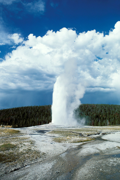 Wyoming: Yellowstone National Park.  Old Faithful Geyser.  Photo #: wyyell104..Photo copyright Lee Foster, www.fostertravel.com, 510/549-2202, lee@fostertravel.com.